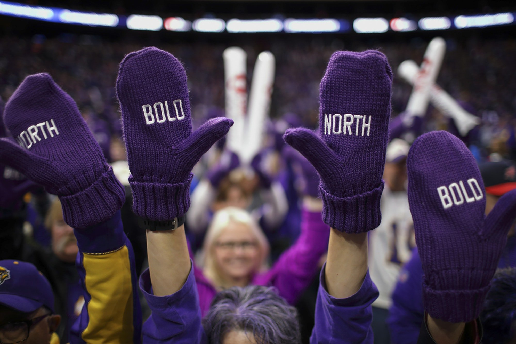"Fans at the Super Bowl wearing ""Bold North"" mittens, produced by Creative Resources"